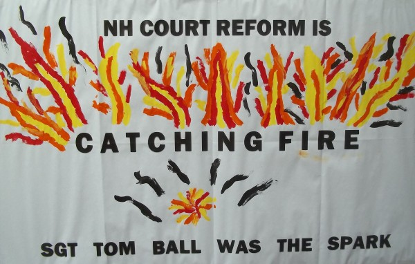 Poster at a memorial for Tom Ball, an MRA who advocated burning down courthouses and police stations.