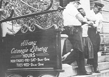 "Student arrested for trying to read a book in a ""white only"" library in Albany, Georgia, 1963."