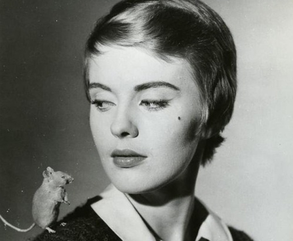 Hideous short-haired monster JEan Seberg poses with adorable mouse.